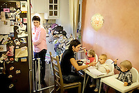Lesbian couple Lada, 33, (left) and Irina (31) at home feeding their three children. Some religious and conservative groups within Russia advocate the forced removal of children from all LGBT families. With increasing violent, verbal and legal attacks on LGBT-rights the lesbian couple say they don't feel safe and their concern that such a law could be enacted has made them consider leaving the country. /Felix Features (MANDATORY CREDIT   photo: Mads Nissen/Panos Pictures /Felix Features)