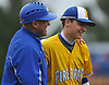 Michael Repoli #22, Kellenberg left fielder, gets a pat on the back from head coach Chris Alfalla after the top of the fifth inning of the Nassau-Suffolk CHSAA varsity baseball championship against St. John the Baptist at Hofstra University on Monday, May 29, 2017. Repoli made a running catch near the left-centerfield wall to rob Baptist of an extra base hit with no outs in the frame and allow the Firebirds to preserve their 1-0 lead at the time. Kellenberg went on to win by that same score to claim the league crown for the second consecutive year.
