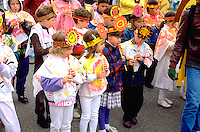 Kids playing recorders age 7 through 9.  In the Heart of the Beast May Day Festival and Parade Minneapolis  Minnesota USA