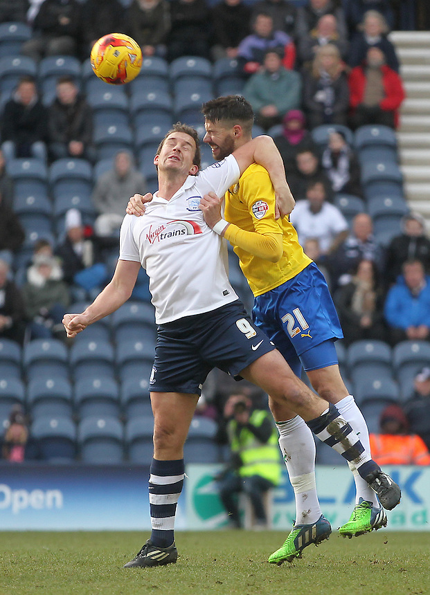 Preston North End's Kevin Davies jumps with Coventry City's Aaron Martin<br /> <br /> Photographer Mick Walker/CameraSport<br /> <br /> Football - The Football League Sky Bet League One - Preston North End v Coventry City - Saturday 7th February 2015 - Deepdale - Preston<br /> <br /> &copy; CameraSport - 43 Linden Ave. Countesthorpe. Leicester. England. LE8 5PG - Tel: +44 (0) 116 277 4147 - admin@camerasport.com - www.camerasport.com