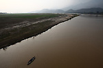 An empty boat floats idly on a river in Quang Nam province, Vietnam.