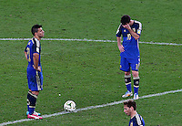 Lionel Messi of Argentina shows a look of dejection after Mario Goetze of Germany scores a goal to make the score 1-0