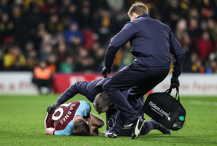 Burnley's Ashley Barnes receiving treatment<br /> <br /> Photographer Andrew Kearns/CameraSport<br /> <br /> The Premier League - Watford v Burnley - Saturday 19 January 2019 - Vicarage Road - Watford<br /> <br /> World Copyright © 2019 CameraSport. All rights reserved. 43 Linden Ave. Countesthorpe. Leicester. England. LE8 5PG - Tel: +44 (0) 116 277 4147 - admin@camerasport.com - www.camerasport.com
