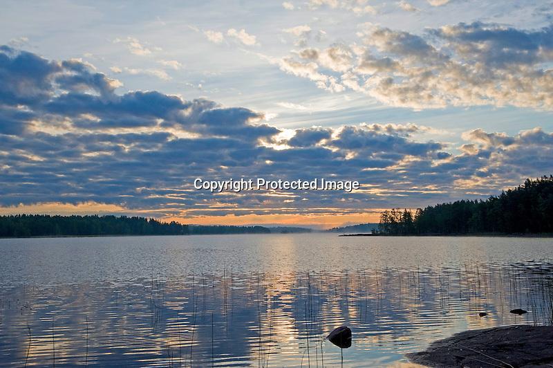 Sunrise on Quiet Näsijärvi Lake during Beautiful Finland Summer