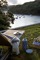 The flat grass roof, which is planted with a variety of wild and ornamental grasses, is the perfect refuge for a solitary picnic with views over the Fowey estuary