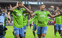 LOS ANGELES, CA - OCTOBER 29: Nouhou Tolo #5 and Roman Torres #29 of the Seattle Sounders FC celebrate their MLS Western Conference victory over Los Angeles FC during a game between Seattle Sounders FC and Los Angeles FC at Banc of California Stadium on October 29, 2019 in Los Angeles, California.