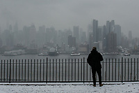 WEEHAWKEN NYJ- FEBRUARY 20: A man stands as the New York skyline is see on the background on February 20, 2019 from Weehawken New Jersey.  (Photo by Kena Betancur/VIEWpress)