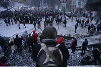 The protest viewed from  the top of a barricade under the snow during the protest against new draconian law to ban protests across the country.  Kiev. Ukraine