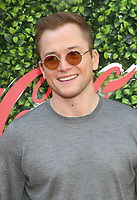 4 January 2020 - Beverly Hills, California - Taron Egerton. the 7th Annual Gold Meets Golden Brunch  held at Virginia Robinson Gardens and Estate. Photo Credit: FS/AdMedia
