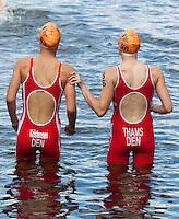 12 JUL 2014 - HAMBURG, GER - Ditte Kristensen (DEN) (left) from Denmark and her team mate Line Thams (DEN) (right) prepare to warm up before the start of the elite women's 2014 ITU World Triathlon Series round in the Altstadt Quarter, Hamburg, Germany (PHOTO COPYRIGHT © 2014 NIGEL FARROW, ALL RIGHTS RESERVED)