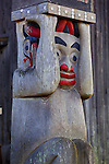 Blake Island State Park, WA  <br /> Totem pole detail view in front of long house entrance at Tillikum Village