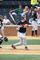 Garrett Kennedy (40) of the Miami Hurricanes follows through on his swing against the Wake Forest Demon Deacons at Wake Forest Baseball Park on March 21, 2015 in Winston-Salem, North Carolina.  The Hurricanes defeated the Demon Deacons 12-7.  (Brian Westerholt/Four Seam Images)