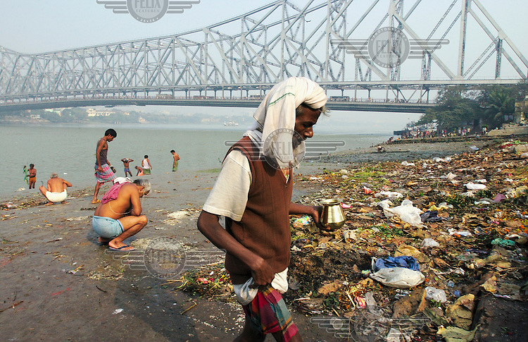 Early morning bathers in the Hooghly River near the old Howrah Bridge.