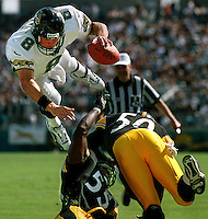 Jacksonville Jaguars quarterback Mark Brunell flies through the air as he makes a leap for the endzone but is stopped short by Pittsburgh Steelers linebackers #55 Joey Porter and #50 Earl Holmes at Alltel Stadium in Jacksonville, Fl.