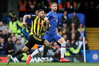 Watford's Andre Gray races into the Chelsea penalty area closely marked by Gary Cahill during Chelsea vs Watford, Premier League Football at Stamford Bridge on 5th May 2019