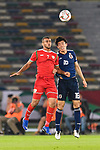 Khalid Al-Hajri of Oman (L) fights for the ball with Tomiyasu Takehiro of Japan (R) during the AFC Asian Cup UAE 2019 Group F match between Oman (OMA) and Japan (JPN) at Zayed Sports City Stadium on 13 January 2019 in Abu Dhabi, United Arab Emirates. Photo by Marcio Rodrigo Machado / Power Sport Images