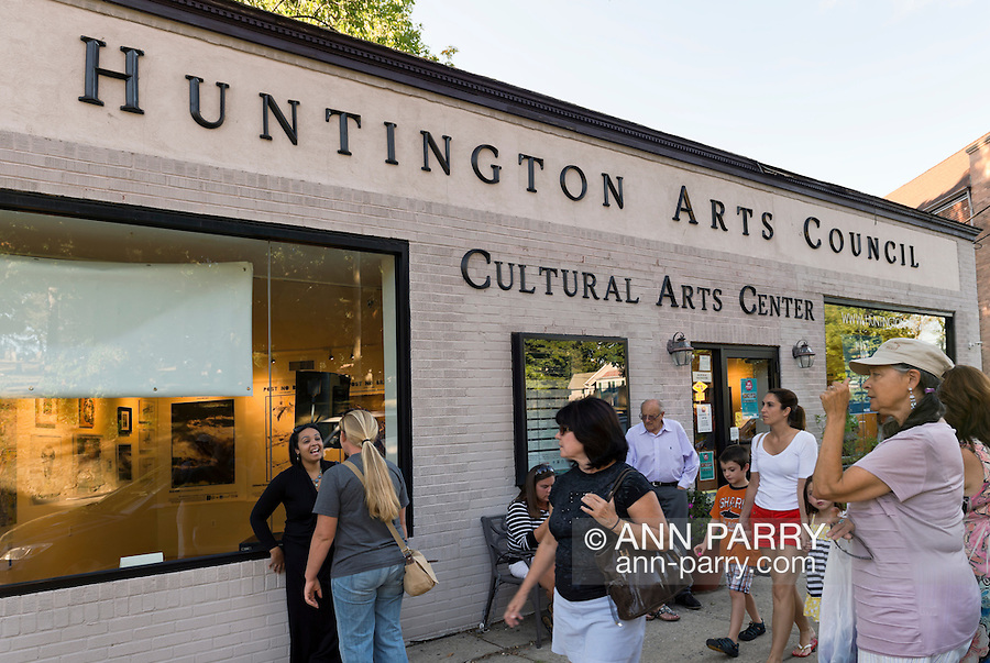 """Huntington, New York, U.S. 24th August 2013. The Huntington Arts Council hosted a gallery exhibit of 12 winning poster for """"Post No Bills"""" after the art event """"Off the Walls"""" Block Party, by SPARKBOOM, a Huntington Arts Council project created to help emerging artists, showcase talents, and help its artistic family network."""