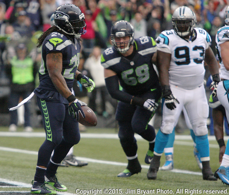 Seattle Seahawks  running back Marshawn Lynch (24) celebrates his 1-yard touchdown against the Carolina Panthers at CenturyLink Field in Seattle on October 18, 2015. The Panthers came from behind with 32 seconds remaining in the 4th Quarter to beat the Seahawks 27-23.  ©2015 Jim Bryant Photography. All Rights Reserved.