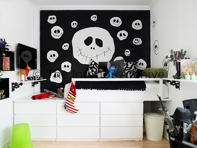 Rie Bidstrup's son Oscar has decorated his room with Halloween faces. Limited space has created an opportunity for creative storage solutions under the raised bed
