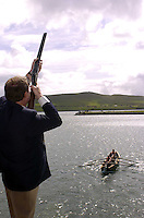 Conor Haughey uses a shotgun to get the annual Dingle Regatta under way on Sunday. His father Charlie had been doing the job for the past 40 years but to declinign health has past on the mantle to his son.<br />