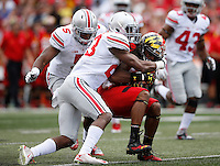 Ohio State Buckeyes safety Tyvis Powell (23) wraps up Maryland Terrapins wide receiver Marcus Leak (82) beside Ohio State Buckeyes linebacker Raekwon McMillan (5) during the Buckeyes' 52-24 win over the Maryland Terrapins in the NCAA football game at Byrd Stadium in College Park, Maryland on Oct. 4, 2014. (Adam Cairns / The Columbus Dispatch)