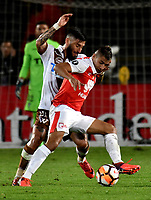 BOGOTA - COLOMBIA - 20 - 02 - 2018: Juan Roa (Der.) jugador de Independiente Santa Fe disputa el balón con Mauricio Medel (Izq.) jugador de Santiago Wanderers, durante partido de vuelta entre Independiente Santa Fe (COL) y Santiago Wanderers (CHL), de la fase 3 llave 1, por la Copa Conmebol Libertadores 2018, jugado en el estadio Nemesio Camcho El Campin de la ciudad de Bogota. / Juan Roa (R) player of Independiente Santa Fe vies for the ball with Mauricio Medel ( (L) player of Santiago Wanderers, during a match for the second leg between Independiente Santa Fe (COL) and Santiago Wanderers (CHL), of the 3rd phase key 1, for the Copa Conmebol Libertadores 2018 at the Nemesio Camacho El Campin Stadium in Bogota city. Photo: VizzorImage  / Luis Ramirez / Staff.