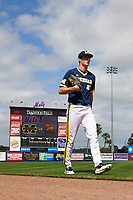 Michigan Wolverines starting pitcher Evan Hill (21) walks to the dugout before the second game of a doubleheader against the Canisius College Golden Griffins on February 20, 2016 at Tradition Field in St. Lucie, Florida.  Michigan defeated Canisius 3-0.  (Mike Janes/Four Seam Images)