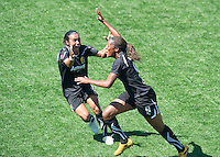 Candice Chapman, right, celebrates with Marta, left, after scoring a goal during the FC Gold Pride's victory over the Philadelphia Independence 4-0, to capture the 2010 WPS Championships in Hayward, Calif., Sunday, September 26, 2010.