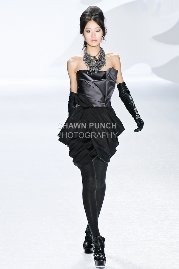 Shu Pei Qin walks runway in a charcoal duchess satin draped bustier dress with black draped tissue weight faille skirt by Vera Wang, during the Vera Wang Fall 2010 fashion show during Mercedes-Benz Fashion Week.