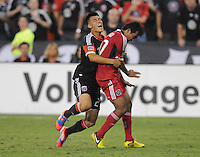 D.C. United forward Long Tan (27) collides  with Chicago Fire midfielder Pavel Pardo (17)  D.C. United defeated The Chicago Fire 4-2 at RFK Stadium, Wednesday August 22, 2012.