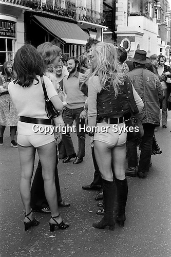 Girls wearing 'Hot Pants', stylish, fashionable in the 1970s. Beauchamp Place, Knightbridge London SW3 UK..