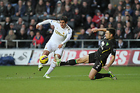 Barclays Premier League, Swansea City (White) V Norwich City (black) Liberty Stadium, Swansea, 08/12/12<br /> Pictured: Swansea's Danny Graham has a first half shot at goal<br /> Picture by: Ben Wyeth / Athena <br /> Athena Picture Agency<br /> info@athena-pictures.com