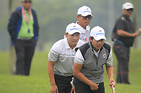 Sunghoon Kang and Poom Saksansin (Asia) on the 5th green during the Saturday Foursomes of the Eurasia Cup at Glenmarie Golf and Country Club on the 13th January 2018.<br /> Picture:  Thos Caffrey / www.golffile.ie