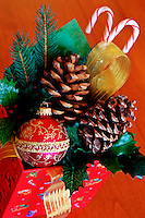 Christmas gift box with pine cone ornament and candy canes