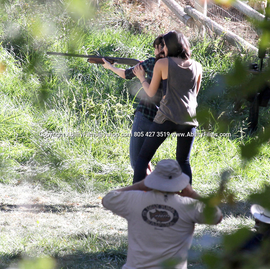 NOVEMBER 5TH 2012   EXCLUSIVE <br />  <br /> Olivia Munn &amp; ZOOEY DESCHANEL SHOOTING A SHOTGUN WHILE FILMING THE TV SHOW NEW GIRL IN THOUSAND OAKS  CALIFORNIA.  Zooey was jumping up &amp; down wresting with the gun &amp; pointing it at co-stars for the scene. Zooey made sure to put her ear plugs in before each shot. Also on set Jake Johnson , Max Greenfield , Hannah Simone , <br /> <br /> <br /> AbilityFilms@yahoo.com<br /> 805 427 3519<br /> www.AbilityFilms.com