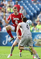 HOOVER, AL - DECEMBER 09, 2012: Eriq Zavaleta (2) of Indiana University pushes the ball past Joey Dillon (4) of Georgetown University during the NCAA 2012 Men's College Cup championship, at Regions Park, in Hoover , AL, on Sunday, December 09, 2012.