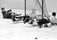 Pittsburg Penguins goalie Al Smith in net after blocking shot by Seals Norm Ferguson . (1970 photo/Ron Riesterer)