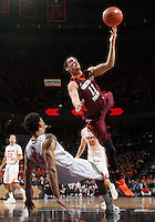 Virginia forward Anthony Gill (13) draws an offensive foul from Virginia Tech guard Devin Wilson (11) during the game Saturday in Charlottesville, VA. Virginia won 65-45. Photo/The Daily Progress/Andrew Shurtleff