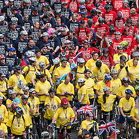 Cyclists participating in the Help for Heroes Hero Ride, totalling to 1,500 including the 300 who took part in the six day Big Battlefields Bike Ride from Paris to London, assembled in formation representing the H4H colours, in Horse Guards Avenue, London preparatory to riding the last miles of the Help for Heroes charity bike ride concluding in the Mall, in front of Buckingham Palace, and ending at Horseguards Parade. The bike ride raised over £1 million for the war wounded and other donations, prompted in part by the killing of drummer Lee Rigby, amounted to a further £1 million. Participants in the combined Hero Ride of 1,500 cyclists included Help for Heroes (H4H) joint founders Bryn and Emma Parry, Tour de France hero Mark Cavendish, Paralympic athlete and former soldier Jon-Allan Butterworth, singer and ex Army officer James Blunt, burns victim from 4 Para Jamie Hull, Page 3 girl Lacey Banghard and 150 wounded veterans. Sunday 2nd June 2013.