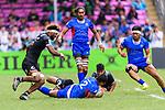 Alamanda Motuga of Samoa (C) is tackled by Jona Nareki of New Zealand (R) during the HSBC Hong Kong Sevens 2018 match between New Zealand and Samoa on April 7, 2018 in Hong Kong, Hong Kong. Photo by Marcio Rodrigo Machado / Power Sport Images