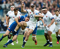 Jonny May of England is tackled by Remy Grosso of France. Natwest 6 Nations match between France and England on March 10, 2018 at the Stade de France in Paris, France. Photo by: Patrick Khachfe / Onside Images
