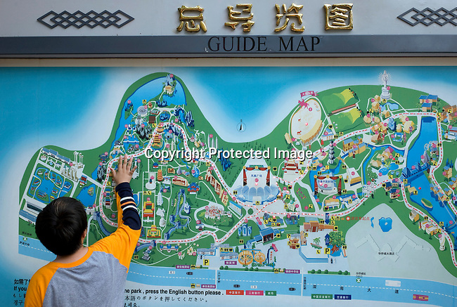 SHENZHEN, CHINA SEPTEMBER 30: A boy touches a colorful guide map inside the entrance of Splendid China Theme park on September 30, 2008 in central Shenzhen, China. The park is one of the most popular in the country, and the popular attractions are the ones showing the diverse cultures of China. Chinese people love theme parks and new ones are opening constantly. It's estimated that there's about 2400 theme parks in the country. Many of the most popular parks are located around Shenzhen and over the border in Hong Kong. (Photo by Per-Anders Pettersson)..