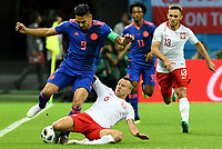 KAZAN - RUSIA, 24-06-2018: Jacek GORALSKI (Der) jugador de Polonia disputa el balón con Radamel FALCAO (Izq) jugador de Colombia durante partido de la primera fase, Grupo H, por la Copa Mundial de la FIFA Rusia 2018 jugado en el estadio Kazan Arena en Kazán, Rusia. /  Jacek GORALSKI  (R) player of Polonia fights the ball with Radamel FALCAO (L) player of Colombia during match of the first phase, Group H, for the FIFA World Cup Russia 2018 played at Kazan Arena stadium in Kazan, Russia. Photo: VizzorImage / Julian Medina / Cont