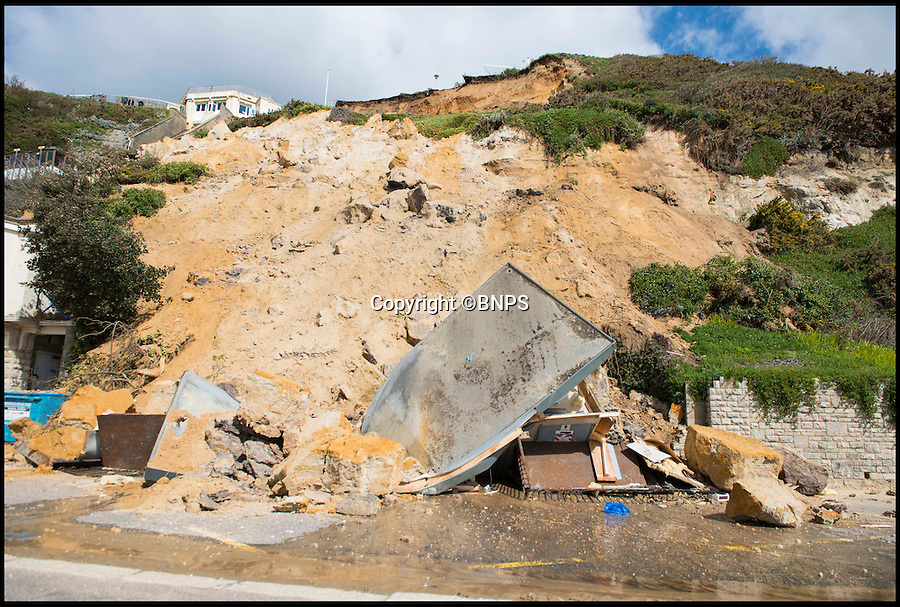 BNPS.co.uk (01202 558833)<br /> Pic: TomWren/BNPS<br /> <br /> Out of order...<br /> <br /> A toilet block has been destroyed by a 50 tonne land slip at a picturesque tourist hot spot in a bustling seaside resort town. <br /> <br /> The mud and rock was torn from the 80ft cliff last night and tumbling boulders have also put a popular Victorian lift out of action. <br /> <br /> Officials have cordoned off a 70ft swathe of beachfront after the rock face crumbled near a memorial to Red Arrow pilot John Egging in Bournemouth.
