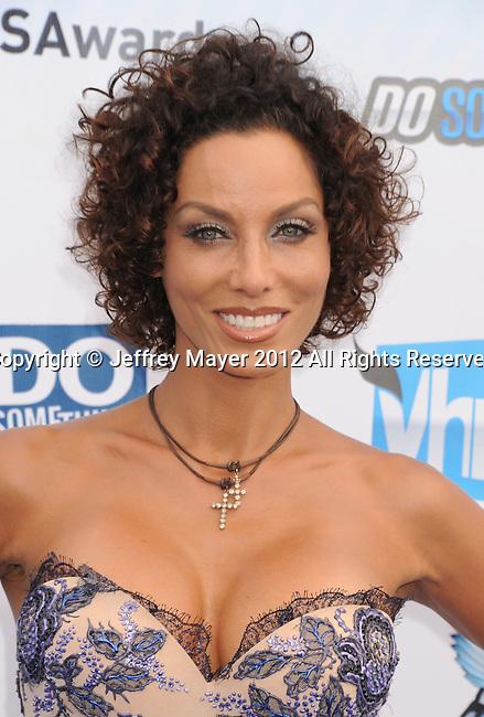 SANTA MONICA, CA - AUGUST 19: Nicole Murphy arrives at the 2012 Do Something Awards at Barker Hangar on August 19, 2012 in Santa Monica, California.
