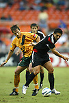 17 July 2004: Andreas Herzog (left) tries to take the ball from Jaime Moreno (right) while Brandon Prideaux (center) looks on. Los Angeles Galaxy tied DC United 1-1 at RFK Stadium in Washington, DC during a regular season Major League Soccer game..