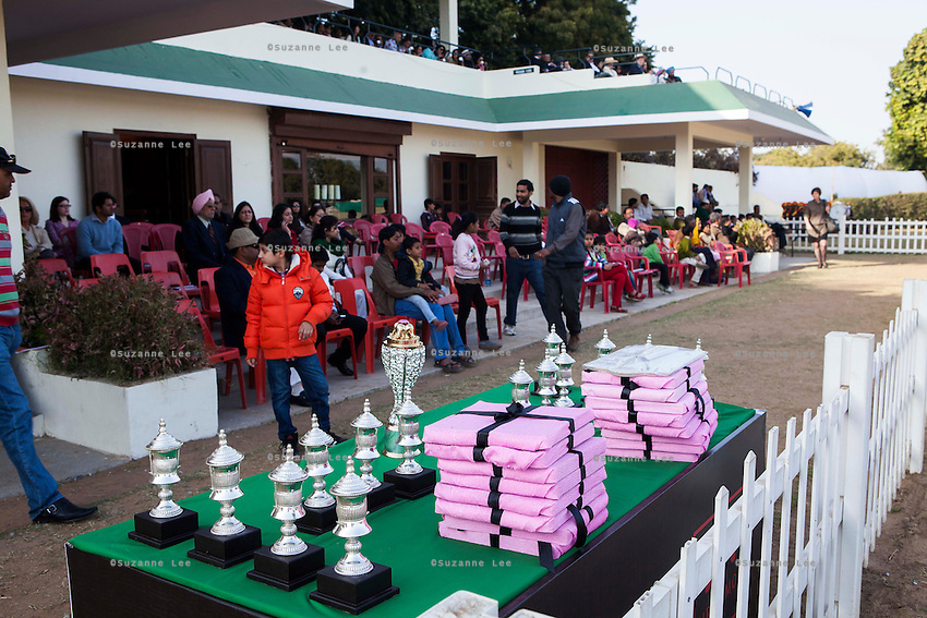 Trophies and prizes are displayed as spectators watch the game between the Royal Jaipur Polo Team and the Western Australia Polo Team for the Argyle Pink Diamond Cup, organised as part of the 2013 Oz Fest in the Rajasthan Polo Club grounds in Jaipur, Rajasthan, India on 10th January 2013. Photo by Suzanne Lee