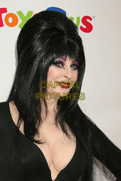 "CASSANDRA PETERSON aka Elvira.Dream Halloween ""Under The Big Top"" Benefit for the Children Affected by AIDS Foundation held at Barker Hangar, Santa Monica, California, USA,.27 October 2007..costume party Halloween fancy dress portrait headshot black wig  Morticia make-up.CAP/ADM/RE.©Russ Elliot/AdMedia/Capital Pictures."