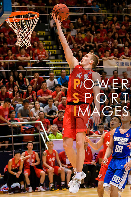Dominic Robert Gilbert #11 of SCAA Men's Basketball Team goes to the basket against the Eastern Long Lions during the Hong Kong Basketball League playoff game between Eastern Long Lions and SCAA at Queen Elizabeth Stadium on July 24, 2018 in Hong Kong. Photo by Marcio Rodrigo Machado / Power Sport Images