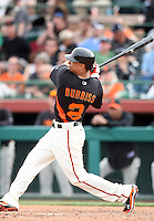 Emmanuel Burriss #2 of the San Francisco Giants bats against the Arizona Diamondbacks in the first spring training game of the season at Scottsdale Stadium on February 25, 2011  in Scottsdale, Arizona. .Photo by:  Bill Mitchell/Four Seam Images.